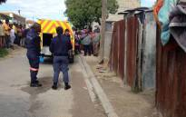 Forensic teams remove the bodies of six family members killed in shack fire. Picture: Lauren Isaacs/EWN