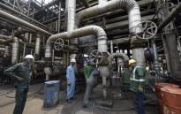 Workers rehabilitate the new Port Harcourt refinery built in 1989 at the same site where the first refinery in Nigeria was built in 1965 in oil rich Port Harcourt, Rivers State. Picture: AFP.