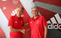 New Ajax Cape Town head coach Muhsin Ertugral (left) shake hands with club CEO Ari Efstathiou (right). Picture: Twitter/@ajaxcapetown