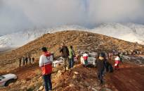 FILE: A handout picture released on 19 February 2018 by the Tasnim news agency shows members of a rescue team searching for the wreckage of Aseman Airlines flight EP3704 in Iran's Zagros mountain range. Picture: AFP.