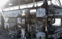 A handout picture provided by the Kazakh emergency situations ministry on 18 January, 2018 shows a charred bus on a road in the region around the city of Aktobe. Picture: AFP