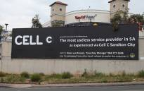 FILE: The banner erected by a disgruntled Cell C customer outside the World Wear shopping centre on Beyers Naude Drive in Fairlands. Picture: Reinart Toerien/EWN