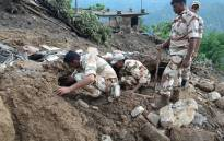 FILE: Indian soldiers searching for survivors of a landslide. Picture: AFP.