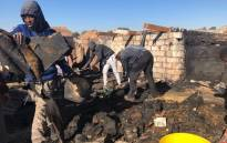 Alexandra residents rebuild after 20 shacks caught fire. Picture: Mia Lindeque/EWN.