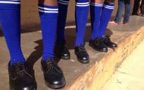 FILE: Learners show off their new school uniforms. Picture: Barry Bateman/EWN
