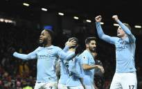 Manchester City's English midfielder Raheem Sterling (L) and Manchester City's Belgian midfielder Kevin De Bruyne (R) celebrate at the end of the English Premier League football match between Manchester United and Manchester City at Old Trafford in Manchester, northwest England, on 10 December 2017. Picture: AFP.