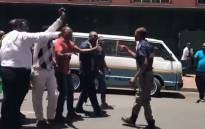 A screengrab of Revelation Church of God church members assaulting a JMPD officer in Johannesburg.