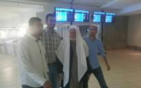 Sheikh Abdul Salam Bassiouni, second from right, surrounded by relatives at OR Tambo International Airport. Picture: Facebook.com.