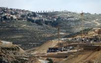 Workers and bulldozers work at a construction site in the Israeli settlement of Givat Zeev near the West Bank city of Ramallah. Picture: AFP.