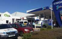 FILE: Police gather at the Engen garage in Gardens following the fatal shooting of Toufieq Joseph on 24 January 2015. Picture: Natalie Malgas/EWN.