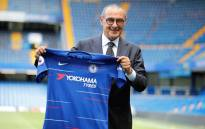Chelsea's newly appointed manager, Maurizio Sarri, holds up a team football shirt as he poses for photographs on the pitch following his unveiling press conference at Stamford Bridge in west London on July 18, 2018. Picture: AFP