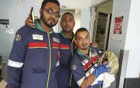 Paramedics pictured after rescuing a baby who was dumped in a rubbish bin in Durban. Picture: @Netcare911_sa