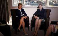 FILE: Britain's Prime Minister Theresa May (R) and Scotland's First Minister Nicola Sturgeon pose for a photograph ahead of their meeting in a hotle in Glasgow, on 27 March 2017.May travelled to Scotland on Monday to try to avert its independence bid while also fighting a political crisis in Northern Ireland. Picture: AFP.