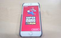 A phone showing Nintendo's 'Super Mario Run' game. Picture: Shimoney Regter/EWN.
