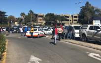 JMPD monitoring Grayston Drive amid protests in the Sandton CDB. Picture: Kgothatso Mogale/EWN.