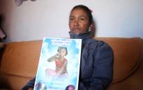 FILE: Juanita Pieters holds a picture of her youngest daughter, Courtney Pieters. A year on and the Pieters family still want answers about their daughter's death. Picture: Bertram Malgas/EWN
