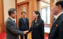 This picture taken on 10 February 2018 and released from North Korea's official Korean Central News Agency (KCNA) on 11 February 2018 shows South Korea's President Moon Jae-in (L) greeting North Korean leader Kim Jong Un's sister Kim Yo Jong (C) as North Korea's ceremonial head of state Kim Yong Nam (R) looking on before their meeting at the presidential Blue House in Seoul. Picture: AFP.