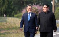 North Korea's leader Kim Jong Un (right) and South Korea's President Moon Jae-in (left) walk together after a tree-planting ceremony at the truce village of Panmunjom on 27 April 2018. Picture: AFP.