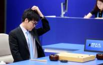 FILE: China's Go player Ke Jie reacts during the first match against Google's artificial intelligence program AlphaGo. Picture: AFP
