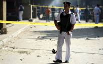 FILE: An Egyptian policeman stands guard at the site of a powerful bomb explosion in the Egyptian capital, Cairo. Picture: AFP
