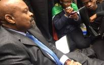 High Commissioner Obed  Mlabo sits on the floor with students during  Fees Must Fall protest in London. Picture: EWN