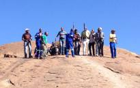 Miners gather on the koppie in Marikana ahead of the anniversary of the shooting in which 34 miners were killed. Picture: EWN.