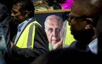 FILE: A portrait of struggle stalwart Ahmed Kathrada is carried with the procession as his coffin is taken to the grave at Westpark cemetery in Johannesburg on 29 March 2017. Picture: Reinart Toerien/EWN
