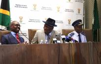 Home Affairs Minister Malusi Gigaba, Police Minister Bheki Cele and National Police Commissioner Lieutenant-General Khehla Sitole hold a press briefing on a significant breakthrough on corruption within the prison and Home Affairs environment. Picture: Christa Eybers/EWN.
