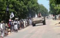 A screengrab taken on November 9, 2014 shows Boko Haram fighters parading on a tank in an unidentified town. Picture: AFP.