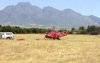 FILE: A helicopter prepares to go into action to try and extinguish a runaway fire between Franschhoek and Paarl on 29 January 2013. Picture: Regan Thaw/EWN