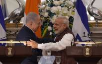 Indian Prime Minister Narendra Modi (R) hugs Israeli Prime Minister Benjamin Netanyahu during a press conference at Hyderabad House in New Delhi on 15 January 2018.  Picture: AFP.