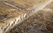 Riders wind their way down dusty farm tracks around Tulbach during Stage 1 of the Absa Cape Epic on 14 March 2016. Picture: Aletta Harrison/EWN.