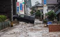 A picture shows cars trapped in the mud after floods in Saka, Hiroshima Prefecture on 8 July 2018. Picture: AFP.