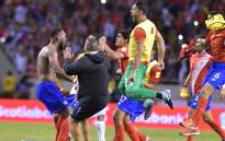 Costa Rica's Kendall Waston celebrates with teammates after qualifying for the 2018 World Cup, in San Jose on 7 October 2017. Picture: AFP.