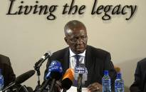 Dikgang Moseneke talks on 3 February 2014 during a press conference. Picture: AFP/Alexander Joe.