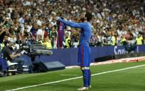 Barcelona's Argentinian forward Lionel Messi celebrates after scoring during the Spanish league Clasico football match Real Madrid CF vs FC Barcelona at the Santiago Bernabeu stadium in Madrid on 23 April, 2017. Picture: AFP.