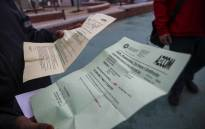 A Blikkiesdorp resident shows the documents she received regarding her RDP housing status. Picture: Cindy Archillies/EWN