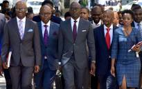 Finance Minister Malusi Gigaba (center) arrives at Parliament flanked by Deputy Minister Buthelezi (second left), SARS Commissioner Moyane (right) and Treasury Director-General Dondo Mogajane (left). Picture: GCIS