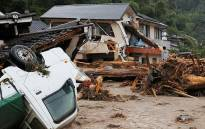 At least 10 people were reported missing and 400,000 evacuated as heavy rain pounds Japan. Picture: AFP.