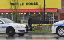 Law enforcement stand outside a Waffle House where four people were killed and two were wounded after a gunman opened fire with an assault weapon on 22 April, 2018 in Nashville, Tennessee. Picture: AFP