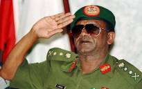 Picture dated 30 August shows former Nigerian President General Sani Abacha at the last session of the summit meeting of the Economic Community of West African States (ECOWAS) in Abuja. Picture: AFP.