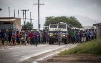 FILE: Residents of Vuwani, escorted by police, make their way into town and to the municipal offices on 6 February 2017. Picture: Thomas Holder/EWN