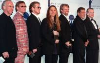 FILE: The Eagles (from left:) Bernie Leadon, Joe Walsh, Don Henley, Timothy Schmit, Don Felder, and Randy Meisner appear together after receiving their awards and being inducted into the Rock & Roll Hall of Fame 12 January in New York. Picture: AFP.