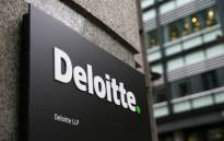 FILE: A Deloitte logo is pictured on a sign outside the company's offices in London on 25 September 2017. Picture: AFP.