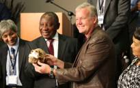 Paleoanthropologist Professor Lee Berger and Deputy President Cyril Ramaphosa hold a replica of one of the Homo naledi fossils at the Cradle of Humankind, 10 September 2015. Picture: Christa Eyber/EWN.""