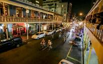 Hundreds of cyclists pour down Long Street on 4 February 2015 as part of the monthly Moonlight Mass night ride in Cape Town. Picture: EWN