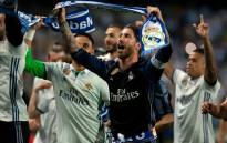Real Madrid captain Sergio Ramos (in blue) leads his teammates in celebration after winning the 2016/2017 La Liga title. Picture: AFP