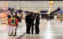 Policemen secure a train station after an axe attack on passengers at the main train station on 9 March, 2017 in Duesseldorf, Germany. Picture: AFP.