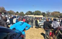 Hundreds of protesting Uber drivers have gathered in Sandton, planning to hand over a memorandum to management. Picture: Katleho Sekhotho/EWN.