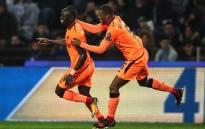 Liverpool's Sadio Mane (left) celebrates a goal with teammate Georginio Wijnaldum. Picture: @GWijnaldum/Twitter